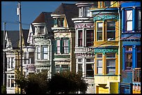 Row of brightly painted Victorian houses, Haight-Ashbury District. San Francisco, California, USA (color)