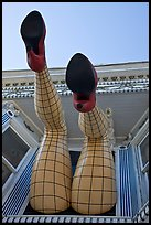 Legs with fishnet stockings hanging from a window, Haight-Ashbury District. San Francisco, California, USA ( color)