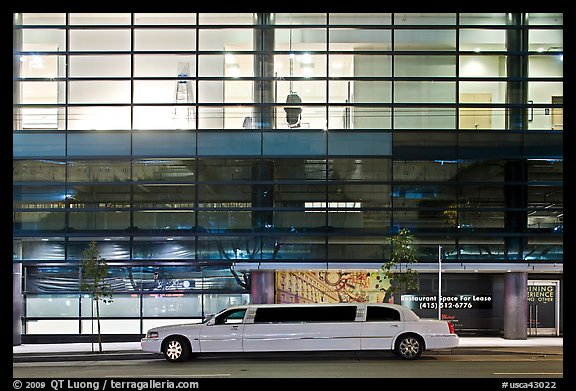 Limousine and glass building. San Francisco, California, USA