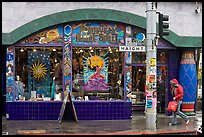 Rainny sidewalk and store with psychadelic colors. San Francisco, California, USA