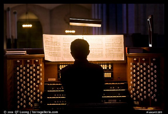 Organist and musical score, Grace Cathedral. San Francisco, California, USA (color)