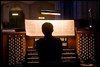 Organist and musical score, Grace Cathedral. San Francisco, California, USA