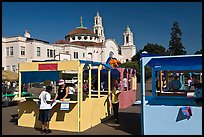 School fair booths and Mission Dolores in the background. San Francisco, California, USA (color)