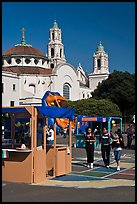 School fair booth, children, and Mission Dolores in the background. San Francisco, California, USA (color)