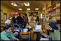Indian family inside popular pizza restaurant, Haight-Ashbury district. San Francisco, California, USA ( color)