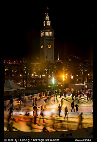 Ice rink and Ferry Building tower at night. San Francisco, California, USA (color)