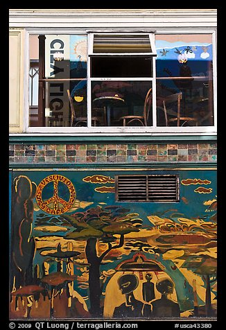 Decor from beatnik period and window reflecting city light sign, North Beach. San Francisco, California, USA (color)