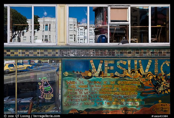 Beatnik area mural and windows with Vesuvio icon and many reflections, North Beach. San Francisco, California, USA