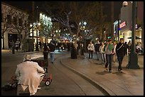 People walking past mime on Third Street Promenade. Santa Monica, Los Angeles, California, USA (color)