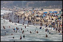 Throng of beachgoers, Santa Monica Beach. Santa Monica, Los Angeles, California, USA (color)