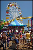 Families, amusement park and ferris wheel. Santa Monica, Los Angeles, California, USA
