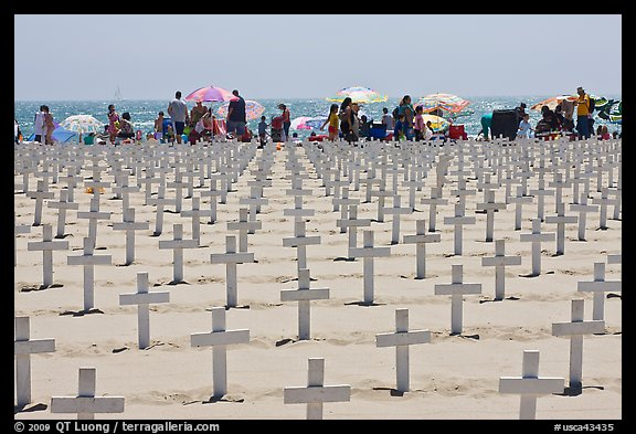 Crosses and beachgoers. Santa Monica, Los Angeles, California, USA (color)