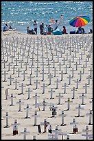 War memorial and families at edge of water on beach. Santa Monica, Los Angeles, California, USA
