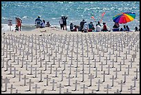 Wooden crosses, stars of David, and beachgoers. Santa Monica, Los Angeles, California, USA (color)