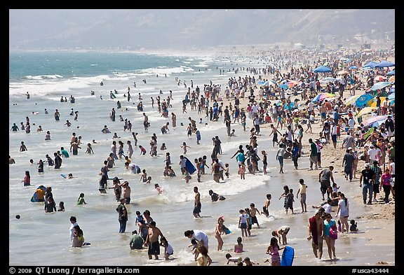 Crowds of beachgoers in water. Santa Monica, Los Angeles, California, USA