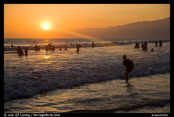Sunset on beach shore, Santa Monica Beach. Santa Monica, Los Angeles, California, USA (color)