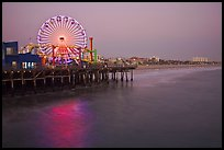 Ferris Wheel and beach at dusk, Santa Monica Pier. Santa Monica, Los Angeles, California, USA