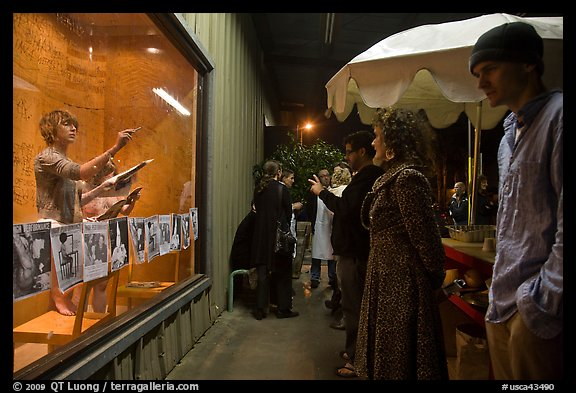 People watch performance artists in window, Bergamot Station. Santa Monica, Los Angeles, California, USA (color)