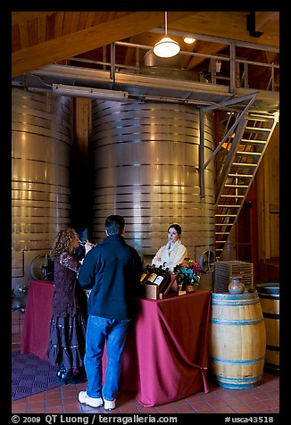 Couple tasting wine. Napa Valley, California, USA (color)