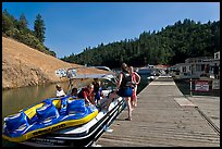 Deck with family preparing a boat, Shasta Lake. California, USA