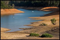 Red earth around an arm of Shasta Lake. California, USA (color)