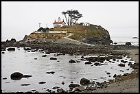 Rocky mound and lighthouse, Crescent City. California, USA ( color)