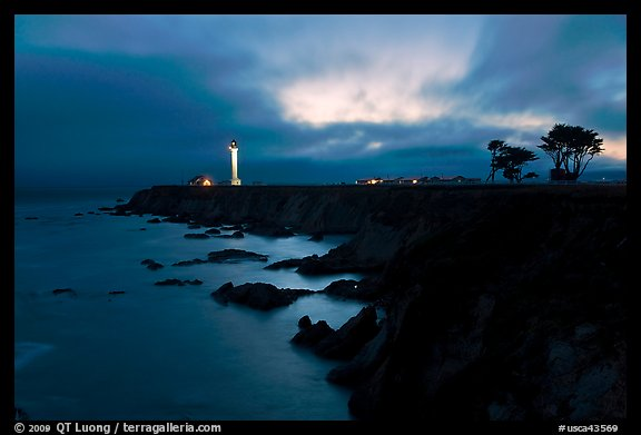 Coastal bluff with lighthouse at dusk, Point Arena. California, USA (color)