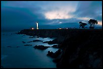 Coastal bluff with lighthouse at dusk, Point Arena. California, USA