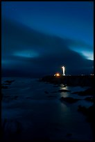 Point Arena Lighthouse and stary sky. California, USA
