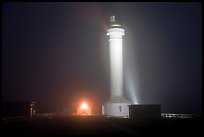 Fog and Point Arena Lighthouse by night. California, USA (color)