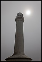 Point Arena Lighthouse and sun through fog. California, USA (color)
