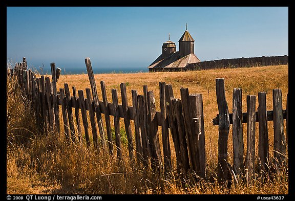 Fences, summer grass and chapel towers, Fort Ross. Sonoma Coast, California, USA (color)