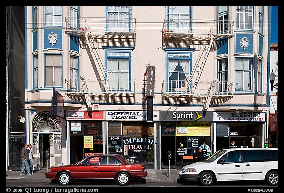 Buildings, cars, and sidewalk, Mission Street, Mission District. San Francisco, California, USA (color)