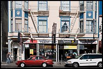 Buildings, cars, and sidewalk, Mission Street, Mission District. San Francisco, California, USA ( color)
