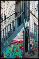 Mural at the bottom of house facade, Mission District. San Francisco, California, USA (color)