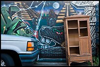 Car, mural, and discarded furniture, Mission District. San Francisco, California, USA (color)