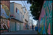 Man walking in alley, Mission District. San Francisco, California, USA ( color)