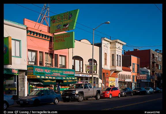 Shops, Mission Street, late afternoon, Mission District. San Francisco, California, USA (color)