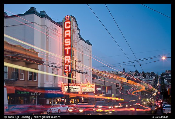 Traffic blurs and Castro Theater at dusk. San Francisco, California, USA (color)