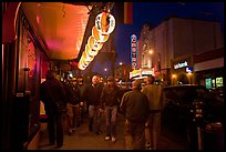 Men walking on sidewalk, Castro street at night. San Francisco, California, USA ( color)