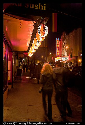 Couple on Castro street at night. San Francisco, California, USA (color)