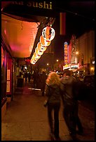 Couple on Castro street at night. San Francisco, California, USA ( color)