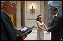 Officiant and couple getting married, City Hall. San Francisco, California, USA (color)