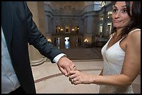 Newly wed bride looks over rings, City Hall. San Francisco, California, USA (color)