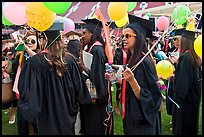 Women students with ballon, commencement. Stanford University, California, USA (color)