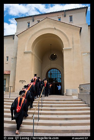 Graduating students in academic robes walk into Memorial auditorium. Stanford University, California, USA (color)