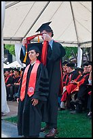 Professor confers doctoral scarf to student. Stanford University, California, USA
