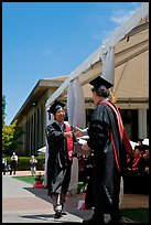 Student receiving handshake prior diploma award. Stanford University, California, USA (color)