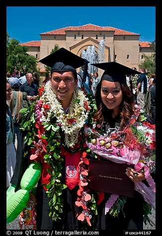 Graduates wearing flower garlands. Stanford University, California, USA (color)