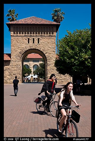 Students riding bicycles through Main Quad. Stanford University, California, USA (color)